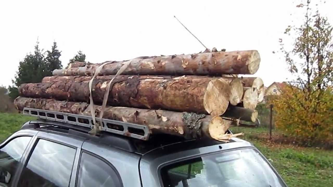 Перевозка бревен на багажнике Лада Калина